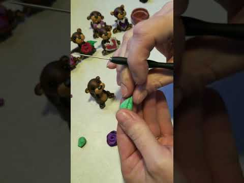 Polymer clay Valentine's otters finishing touches - Simple polymer rose in progress!