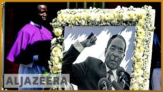 Zimbabwe ex-president Robert Mugabe buried in his native village