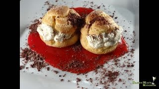 Homemade cream puffs with strawberry coulis