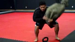 s p e c s training strength endurance with sandbags kettlebells