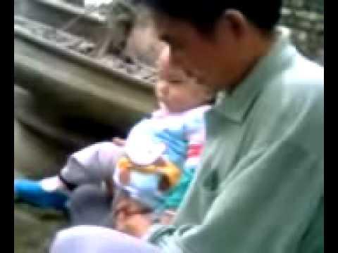 Mẹ Nguyễn Thị Như Quỳnh và bé Nguyễn Quốc Tuấn