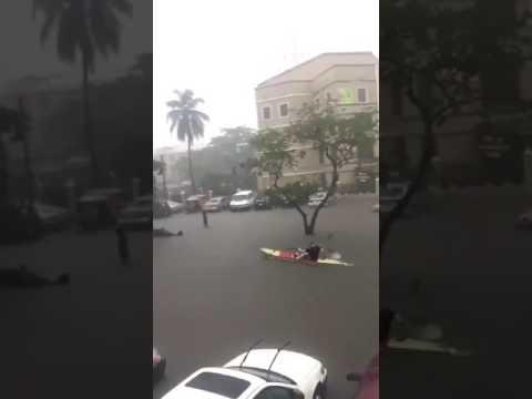 White man canoeing in front of Silverbird Galleria Lekki Ajah