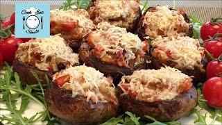 Фаршированные грибы запечённые  под сыром