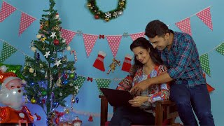 Sweet Christian couple doing online Christmas shopping together using a laptop