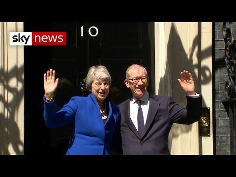 Theresa May waves