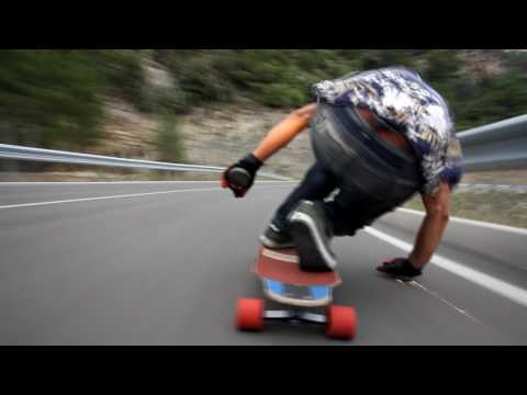 Longboard Rider Cruises and Makes Sparks With His Hands