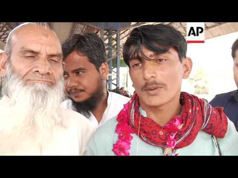 Released Pakistan fishermen arrive in Karachi