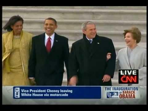 Barack Obama walks George W. Bush to