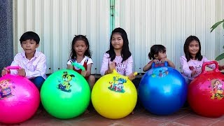 Five Kids Playing with Fitness Exercise Balloons