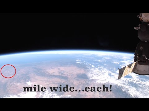"""Huuuuuge """"UFOs"""" appear in ISS live feed 