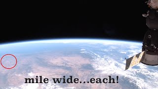 "Huuuuuge ""UFOs"" appear in ISS live feed 