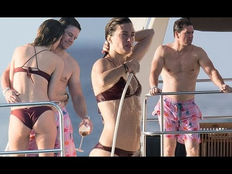 Heating up the Caribbean! Mark Wahlberg cuddles bikini clad wife Rhea Durham as they take a yacht ou