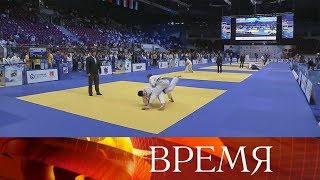Смотреть видео Президент начал поездку в Санкт-Петербург с турнира памяти своего тренера по дзюдо. онлайн