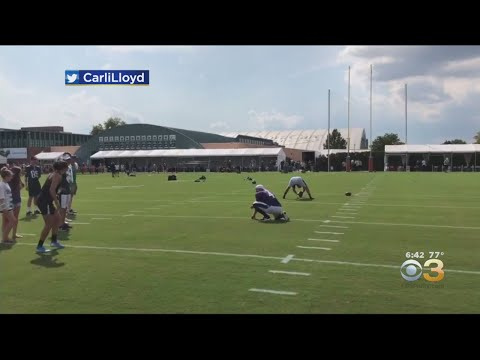 Dana McKenzie - Soccer star Carli Lloyd drills 55-yard field goal at Eagles practice