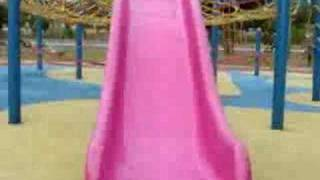 American Mix English Cocker Spaniel Puppy Playing Slides At Playground