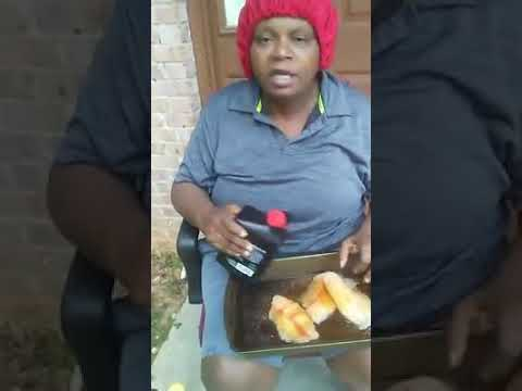A crazy lady using motor oil to cook fish