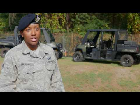 U.S. Airmen from the 116th Security Forces Squadron discuss the Security Forces career field