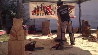 Chain Saw Chick Cuts Wood - Carving A Stump Art Sculpture With A Chainsaw