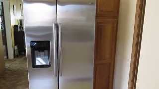 Samsung 24.7 cu. ft. Side by Side Refrigerator with Food Showcase Design RH25H5611SR