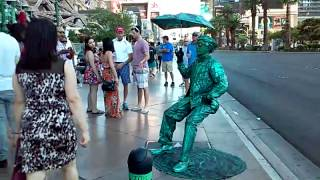 Green man posing as a statue