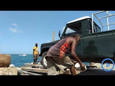 Transporting vehicles using boats in the Indian Ocean from L