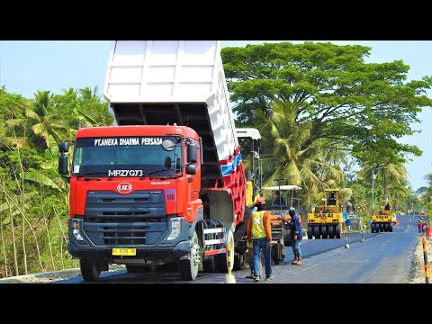 Asphalt Paving Work On Busy Road By Sumitomo HA60C Paver And Quester Dump Trucks