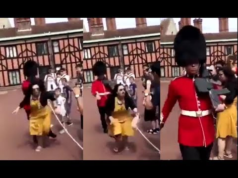 Watch the moment woman tourist pushed away by the Queen's Royal Guard in the Windsor Castle