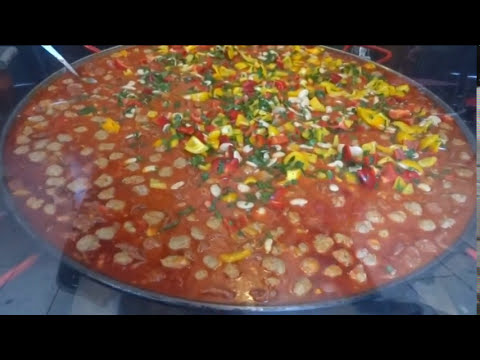 Big Paella, Pulled Pork, Raclette Cheese, Street Food in Borough Market London,