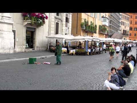 Artisti di strada Piazza Navona Roma Italia Funny street artist at Piazza Navona Rome Italy