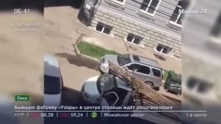Разборки на парковке с топором и битой