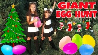 GIANT SURPRISE EGG HUNT at Christmas Tree Lot - Opening Toy Surprises - What's Inside?