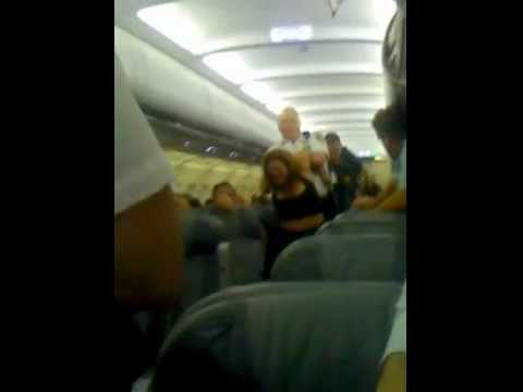 Thumbnail: women gets kicked off plane kicking and screaming