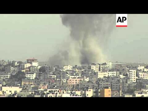 Moment of impact, column of smoke, as Israeli airstrikes continue