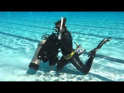 Divemaster Videos | Jess demonstrating BCD remove and replace for PADI open water students