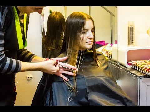 Long haired blonde woman getting a romantic bob haircut for holidays