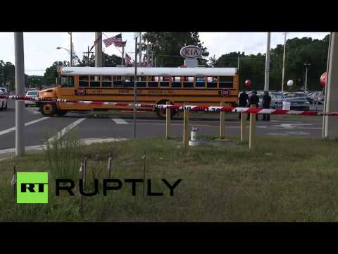 USA: School bus shot, two young female students injured