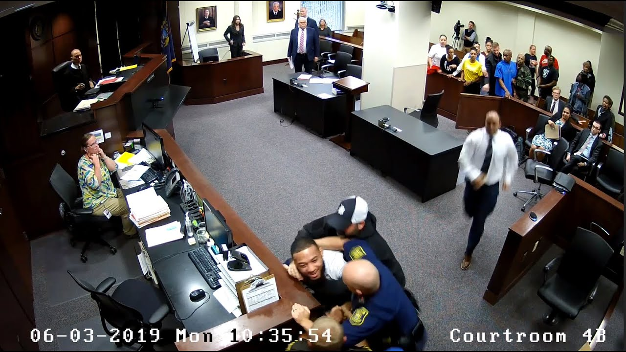 Son Of Slain Woman Tries To Attack Accused Killer In Courtroom..