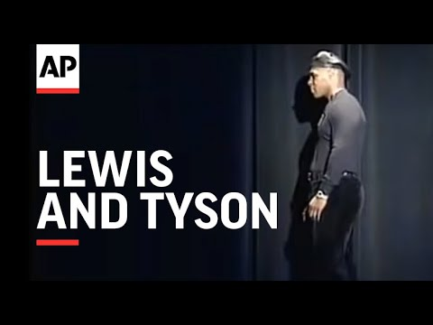 Boxers Lewis and Tyson involved in fight at presser.