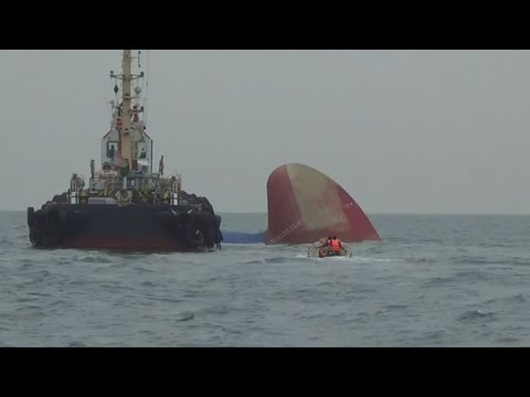 Six missing as fuel-laden tanker sinks in Singapore Strait