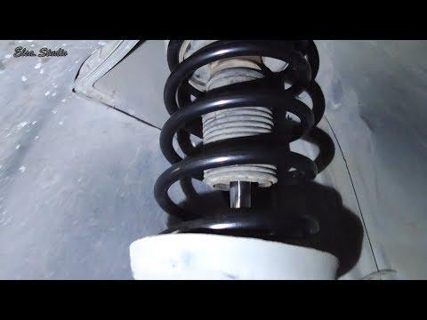 Замена пружины и верхней опоры передней стойки Opel Omega