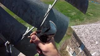 Windmill Fixin'.  Old school water pumper on the Prairie.