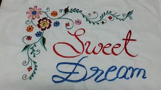 Pillow cover design with writing by machine embroidery