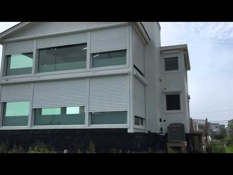 Hamptons Remote controlled exterior security and storm shutters