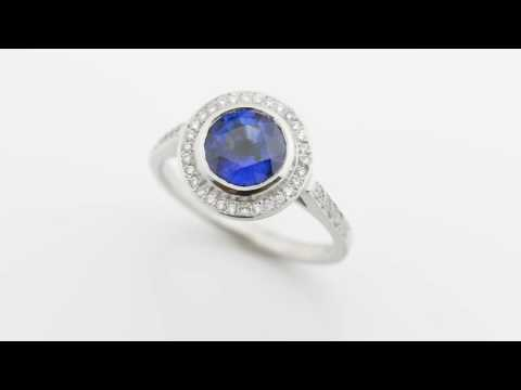 Round blue sapphire and diamond halo cluster ring video 1