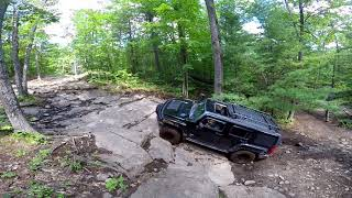 4x4 Off Road Rock Climbing with Muddy Tires