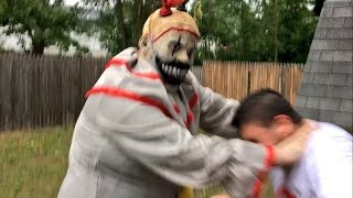 creepy clown from the woods attacks guy in backyard