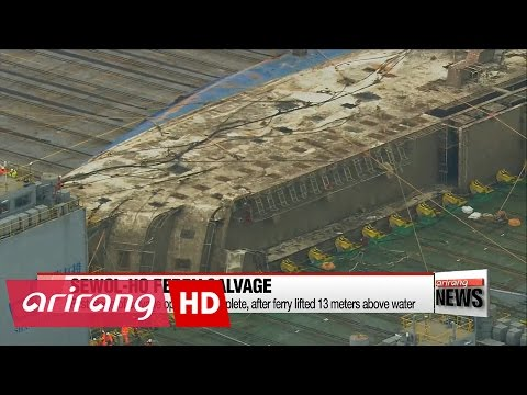 First stage of Sewol-ho salvage operation complete, after ferry hull lifted above water