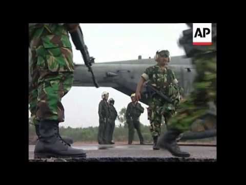 US troops help airlift Indonesian soldiers, aid
