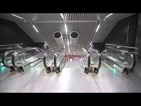 Sweden, Stockholm City train station, 1X inclined elevator, 1X escalator - going down to platform