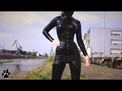 Gia felino black latex catsuit outdoors